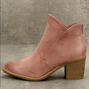 Pink faux suede ankle booties.
